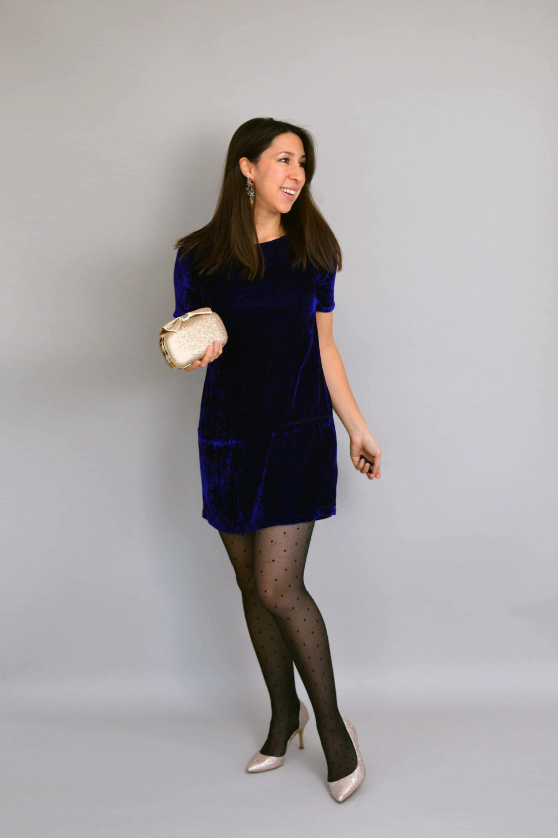Blue velvet Carnaby dress with gold sparkly clutch, gold sparkly shoes and black tights with black spots