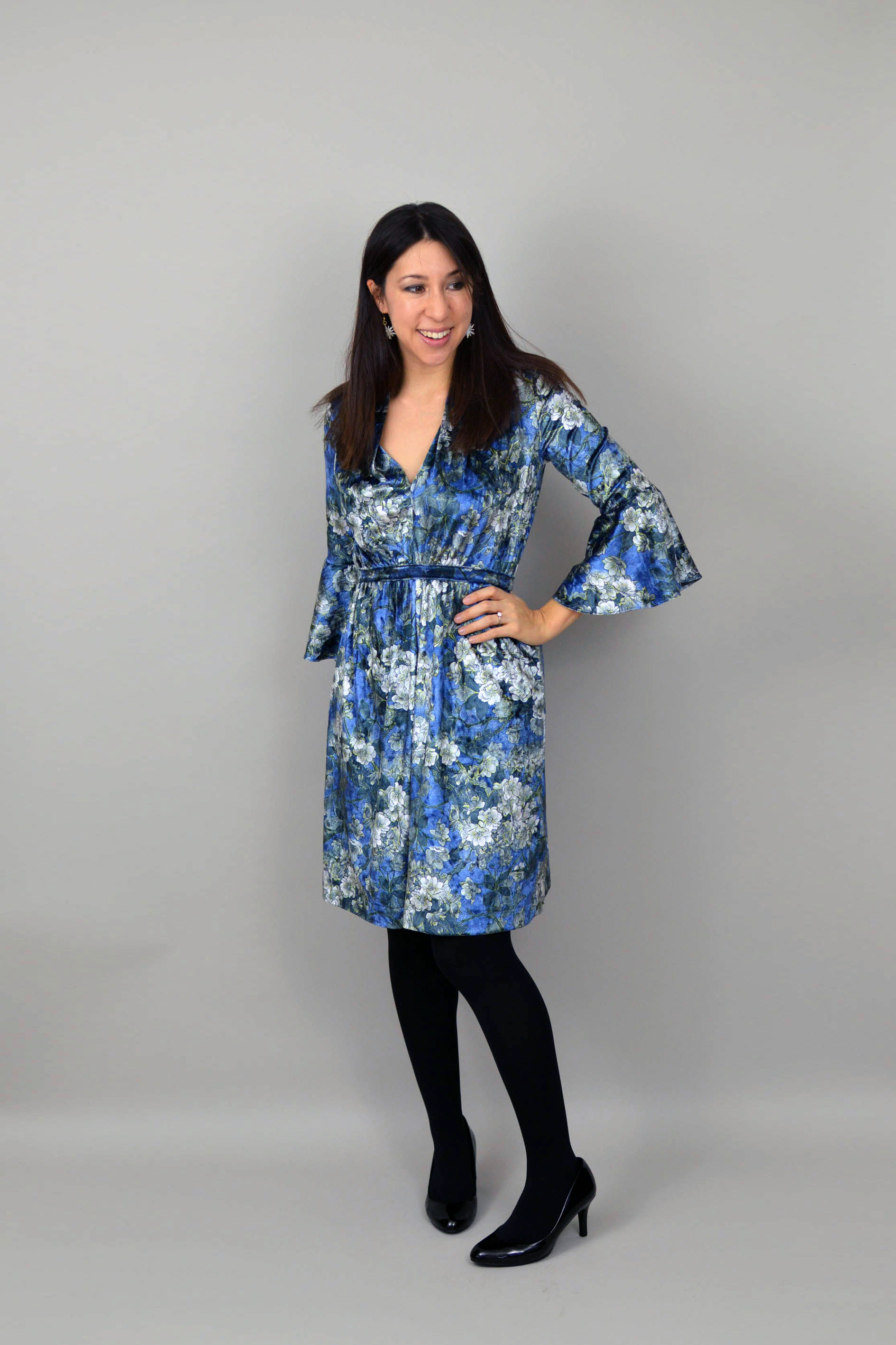 Blue velvet Mayfair dress with frill sleeves, and black shoes and tights