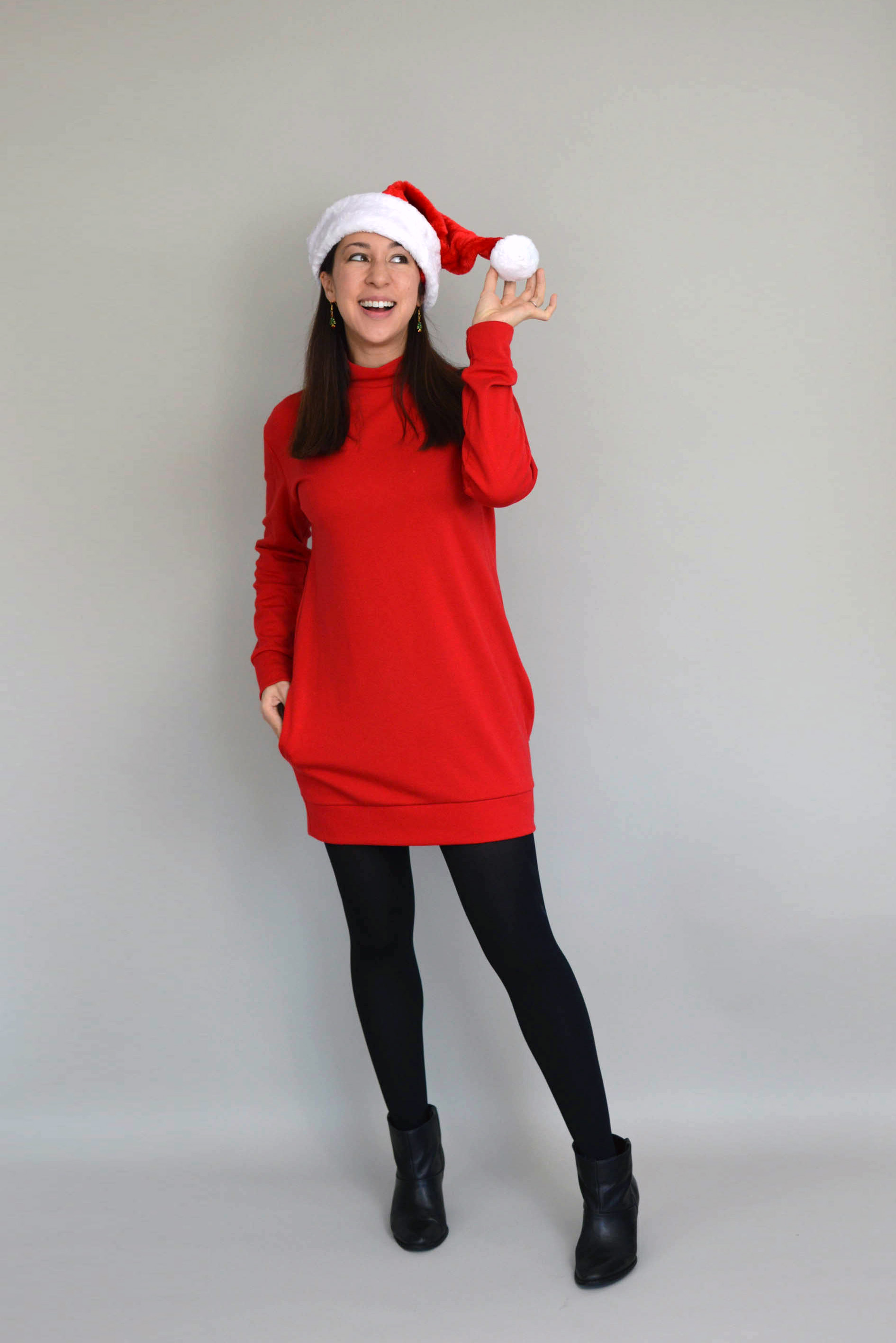 Red Southbank Sweater dress with Santa hat and black boots