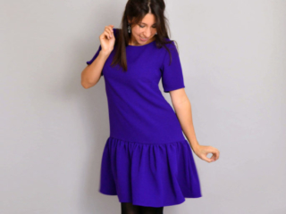 Purple crepe Carnaby dress with gathered skirt with black tights and shoes
