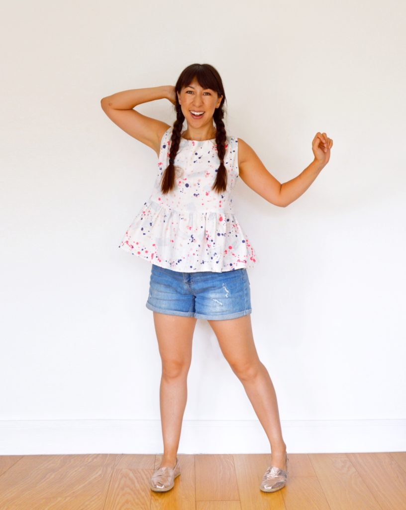 Full body photograph of Nina wearing a Carnaby peplum top hack and shorts